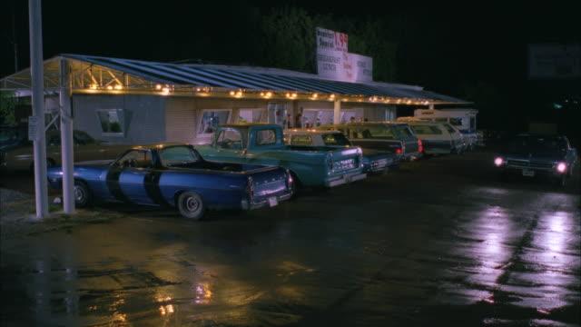 MS Car passing through small rural diner