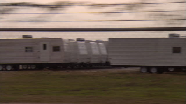 side pov, car passing unused fema travel trailers, new orleans, louisiana, usa - hurricane katrina stock videos and b-roll footage