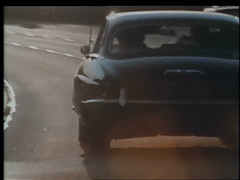 1970 car point of view behind car on highway / los angeles / educational - zweispurige strecke stock-videos und b-roll-filmmaterial