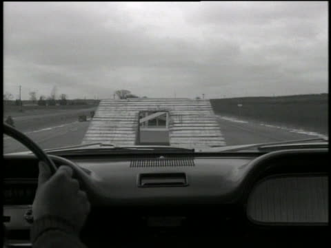b/w 1962 car point of view chevrolet biscayne sedan doing jump between two ramps in test - chevrolet stock videos & royalty-free footage