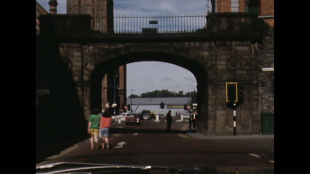 car point of view down street in londonderry, northern ireland; 1969. - car point of view stock videos & royalty-free footage