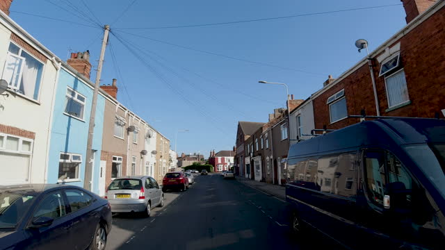 4k car point of view drive down mass dense terrace house street known as an area of poor, poverty and deprivation following the easing of covid19 restrictions in grimsby, north east lincolnshire, uk - district stock videos & royalty-free footage