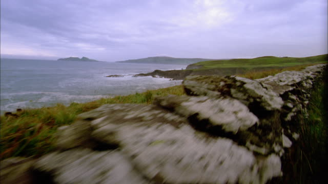 car point of view driving along coast / croagh patrick, ireland - 2002 stock videos & royalty-free footage