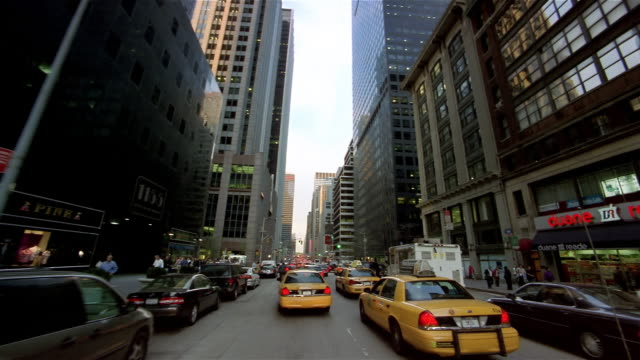 Car point of view driving down avenue in Manhattan / New York City