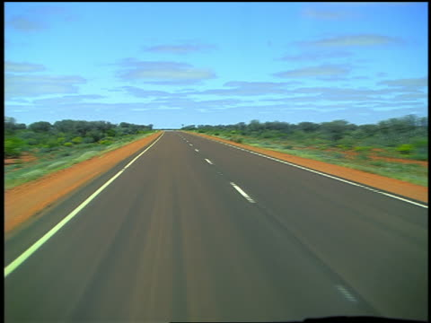 Car point of view driving on highway through plains / Stuart Highway, South Australia