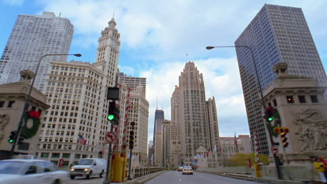 car point of view driving over bridge and street / chicago - 2002 stock videos & royalty-free footage