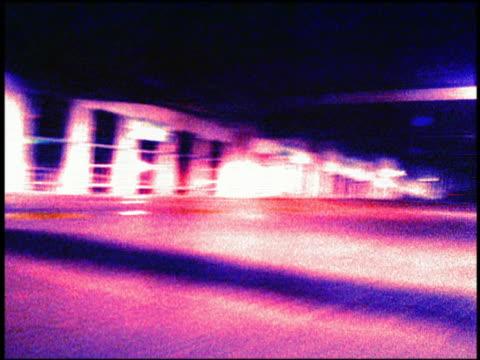 stockvideo's en b-roll-footage met fast motion car point of view driving through ramped parking garage - cross processen
