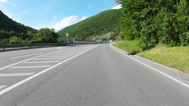 car point of view driving through soča valley - escaping stock videos & royalty-free footage