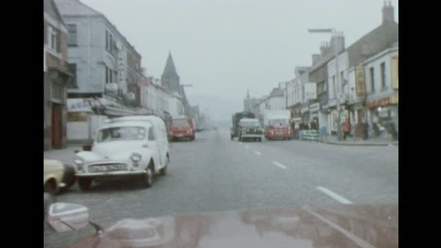 car point of view driving up shankill road in belfast, northern ireland; 1972. - car point of view stock videos & royalty-free footage
