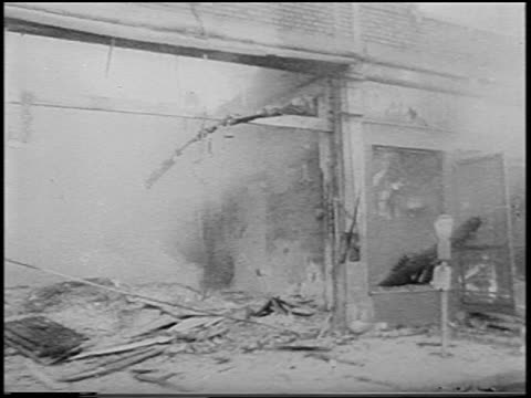 b/w 1967 car point of view going past burning buildings / detroit race riots / newsreel - 1967 stock videos & royalty-free footage