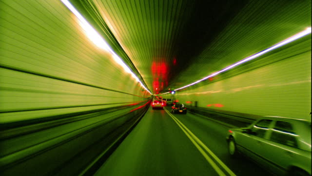 high speed car point of view going thru tunnel / nyc - londonalight stock videos and b-roll footage