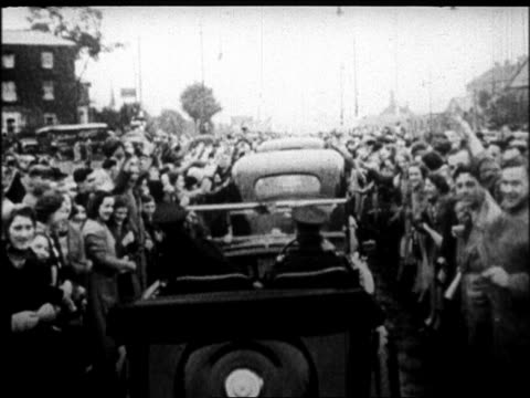 car point of view in motorcade on street lined by cheering crowds / after signing of munich pact - moving process plate stock videos & royalty-free footage
