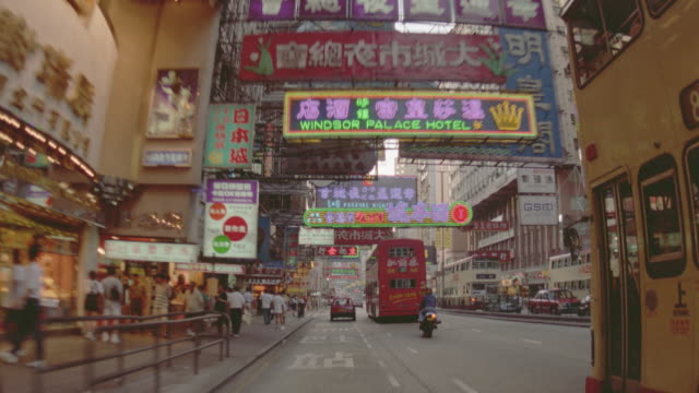 car point of view in traffic on city street with signs / hong kong / nathan road, kowloon - hong kong stock-videos und b-roll-filmmaterial