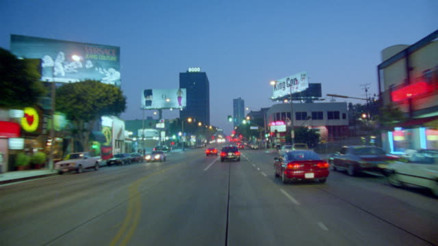 car point of view in traffic on los angeles city street at night - 1998 stock-videos und b-roll-filmmaterial