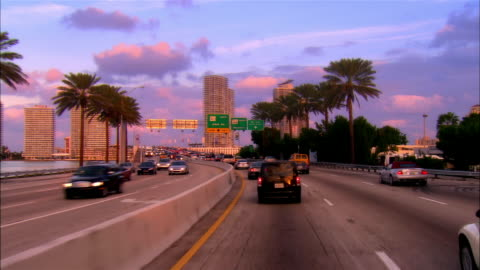 vidéos et rushes de car point of view in traffic on macarthur causeway bridge/ miami, florida - miami
