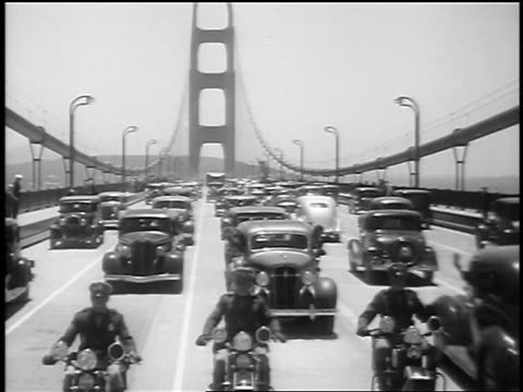 vidéos et rushes de car point of view motorcade driving on golden gate bridge at opening / sf / newsreel - golden gate bridge