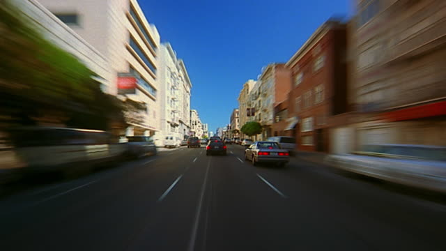FAST MOTION car point of view moving along city street / time lapse traffic / San Francisco