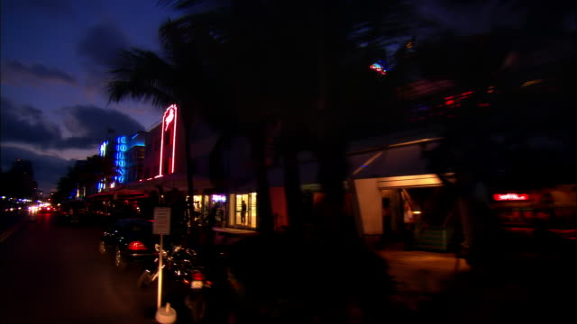 car point of view moving down ocean drive at night/ miami, florida - miami beach stock videos & royalty-free footage
