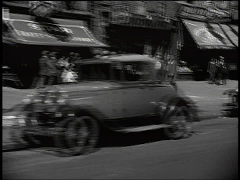 stockvideo's en b-roll-footage met b/w car point of view of harlem sidewalk with people + stores / new york city - 1920