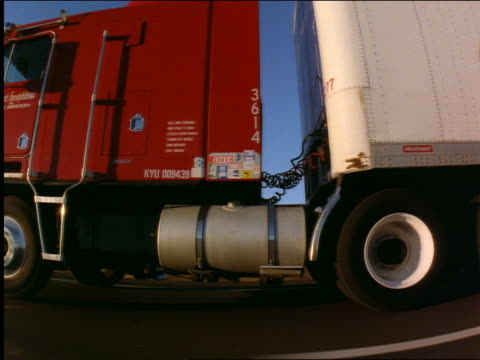 Car point of view of tractor trailer on country highway