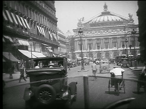 b/w 1926 car point of view on avenue de l'opera with traffic toward l'opera garnier / paris, france - 1926 stock videos & royalty-free footage