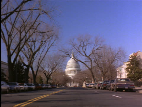 Car point of view on city street toward Capitol Building / Washington DC