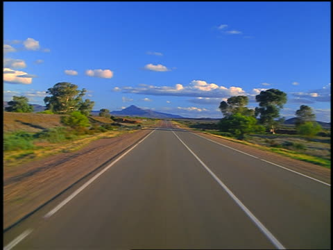 car point of view on highway through plains toward mountains / flinders ranges, south australia - car point of view stock videos & royalty-free footage