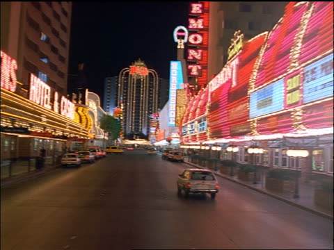 car point of view on las vegas strip past casinos + hotels at night / flash frames - 1993 stock-videos und b-roll-filmmaterial