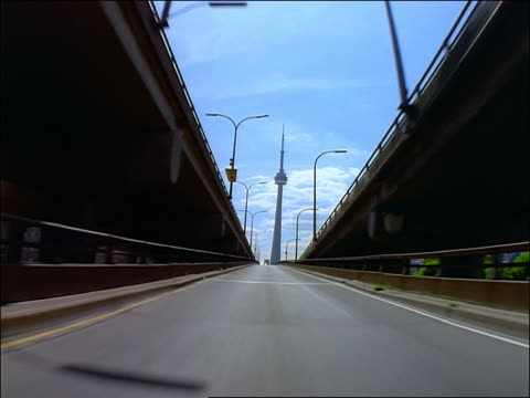 car point of view on ramp to gardiner expressway towards cn tower / toronto - car point of view stock videos and b-roll footage
