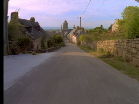 car point of view on road thru village past houses / france - rustic stock videos & royalty-free footage