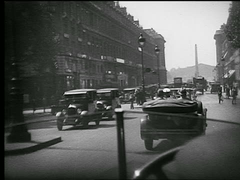 stockvideo's en b-roll-footage met b/w 1926 car point of view on rue royale with traffic toward place de la concorde with the obelisk in background / paris - 1920