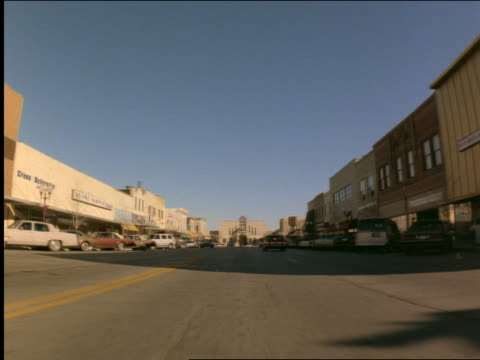 car point of view on street thru town / kansas - cinematography stock videos & royalty-free footage