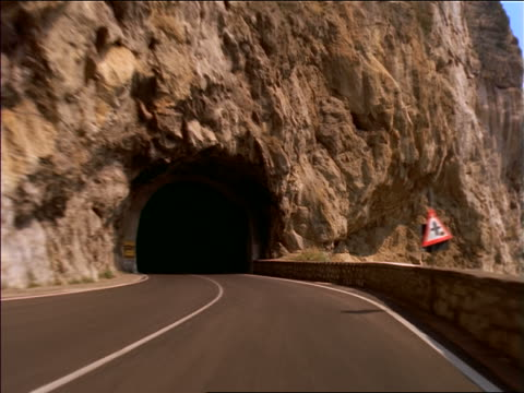 car point of view on windy mountain road thru tunnel / amalfi coast, italy - 1997 stock videos & royalty-free footage