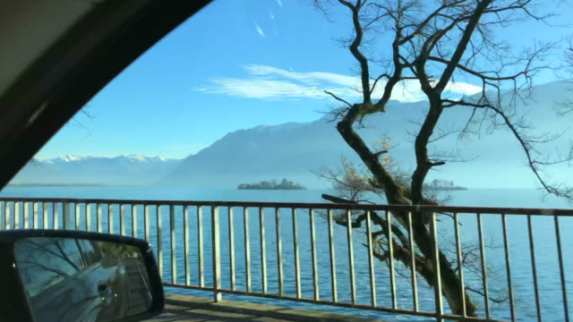 car point of view over alpine lake maggiore with mountain - named wilderness area stock videos & royalty-free footage