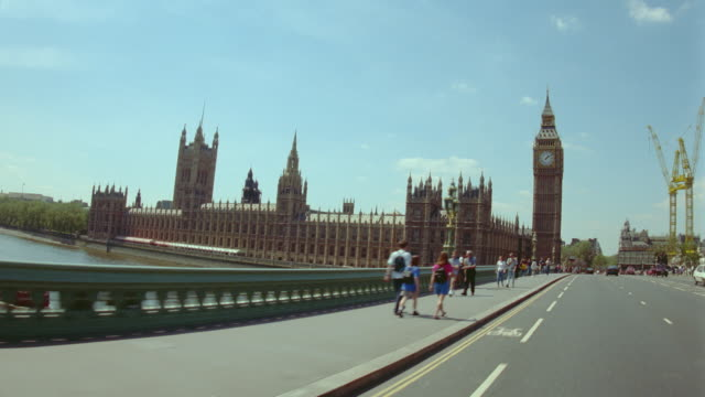 car point of view over thames on westminster bridge toward big ben + parliament / london, england - westminster bridge stock videos & royalty-free footage