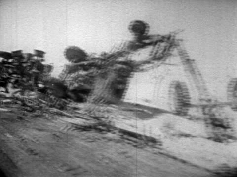 b/w 1967 car point of view past destroyed vehicles on desert road during six day war / newsreel - londonalight stock videos and b-roll footage