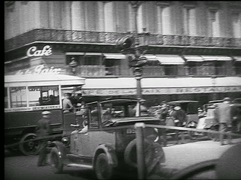 b/w 1926 car point of view past side of l'opera garnier turning toward cafe de la paix / paris, france - 1926 stock videos & royalty-free footage