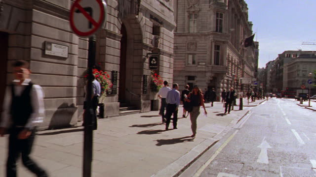 car point of view people walking on sidewalk / london, england - road sign stock videos & royalty-free footage