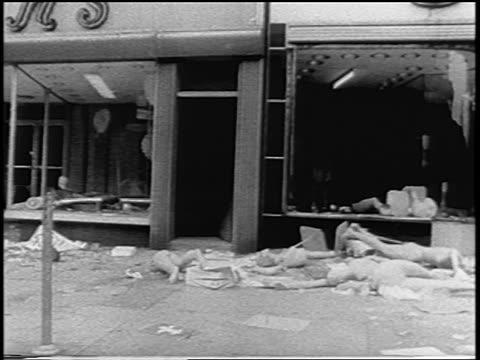 vídeos de stock, filmes e b-roll de b/w 1967 car point of view rubble on city sidewalk senior black woman after newark race riots nj / newsreel - só uma mulher idosa