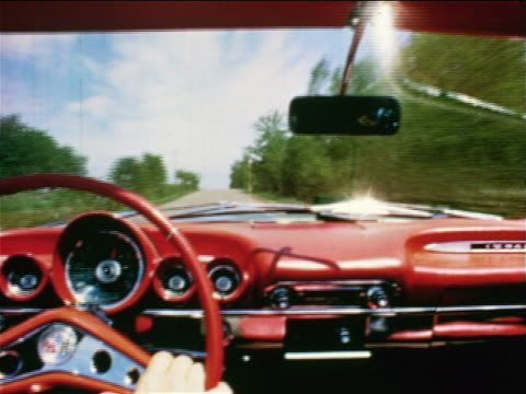 1968 car point of view speeding convertible on country road / man's hand on steering wheel + dashboard visible - prelinger archive stock-videos und b-roll-filmmaterial