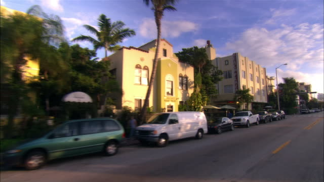 car point of view traffic and buildings on collins avenue/ miami beach, florida - アールデコ点の映像素材/bロール