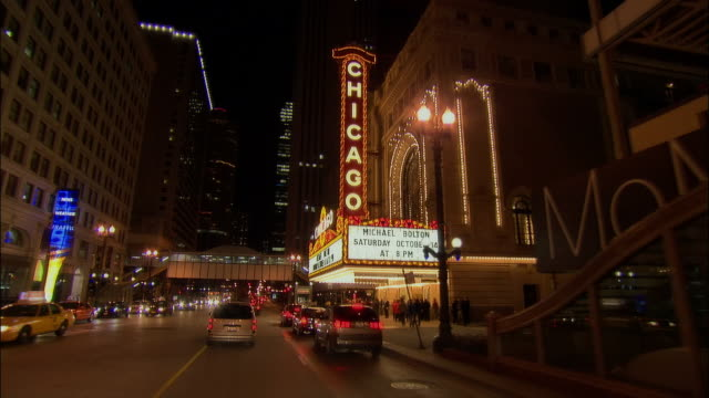 car point of view traffic on state street / past the chicago theatre / chicago, illinois - theater marquee commercial sign stock videos & royalty-free footage