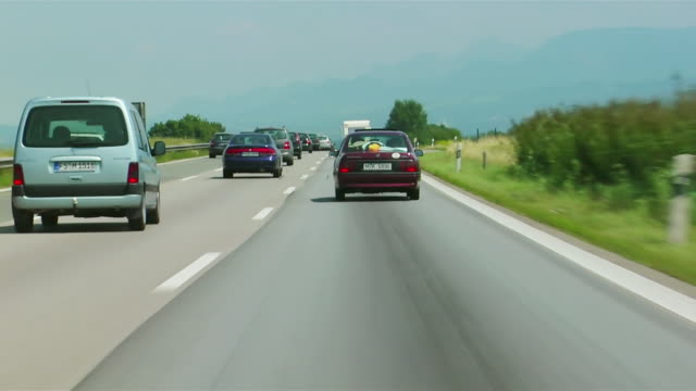car point-of-view driving behind cars on motorway / germany - germany stock videos & royalty-free footage
