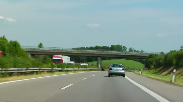 vidéos et rushes de car point-of-view driving behind sedan on motorway / germany - allemagne