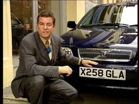 Car Price Regulations Come Into Force ITN Stockport i/c INT MS Front of X registered Rover car TILT BV Salesman kneeling beside car SIDE MS Customer...