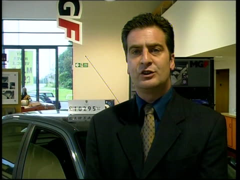 Car Price Regulations Come Into Force ITN Stockport Renault car in showroom with 'X Reg' numberplate BV Customer looking under bonnet of new X reg...