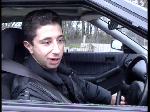 MMC report N London Intercar Car buyer takes keys from car broker Simon Lerner walks to new Mazda 323 car gets in CMS Car CBV Lerner looking at car...