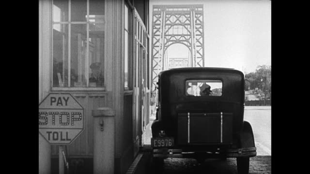 pamphlets car pulling up to bridge toll booth toll booth operator handing pamphlet to driver policeman handing driver in city pamphlet - 1935 stock-videos und b-roll-filmmaterial