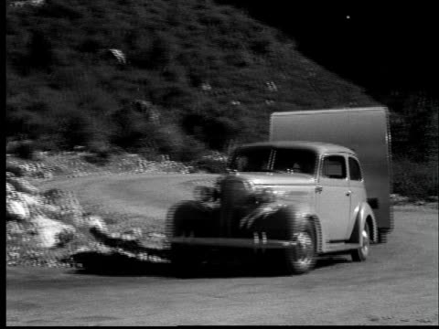 1937 ws car pulls trailer camper up dirt road/ audio - camper trailer stock videos and b-roll footage
