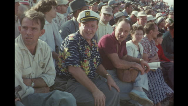 car race at daytona international speedway and spectators in stands daytona beach florida usa - anno 1954 video stock e b–roll